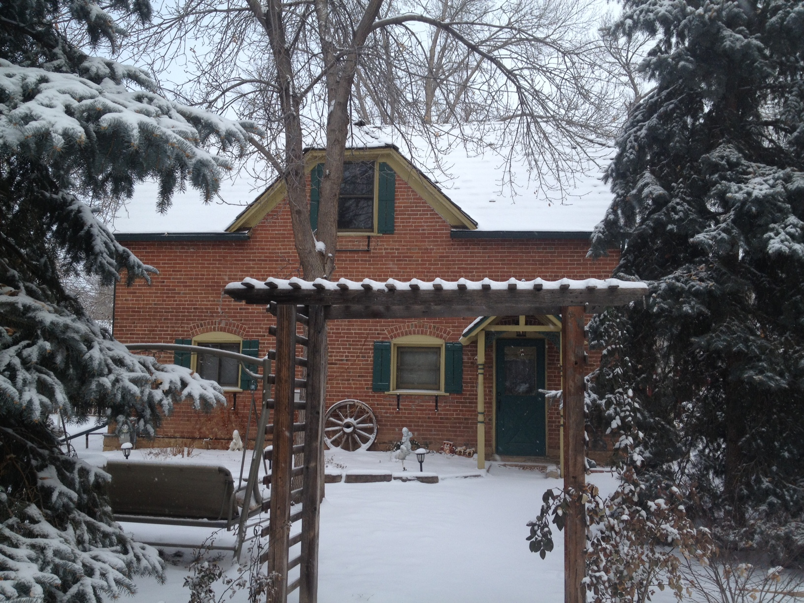 Our cozy cottage blanketed in snow. *swoon*